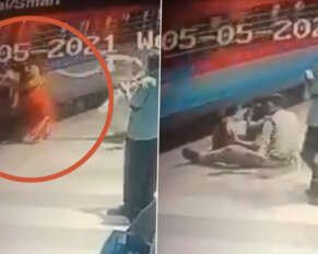Railway police rescue woman falling under train