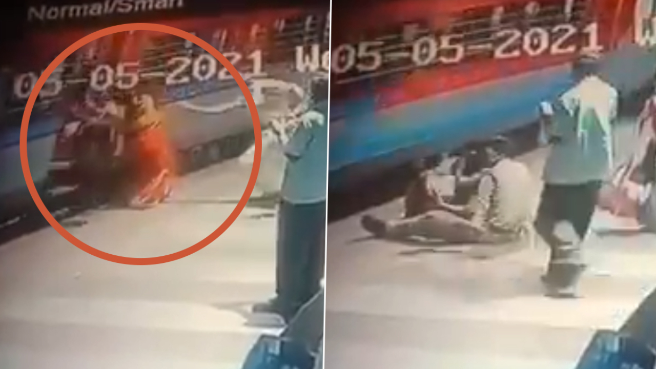 Railway police rescue woman falling under train